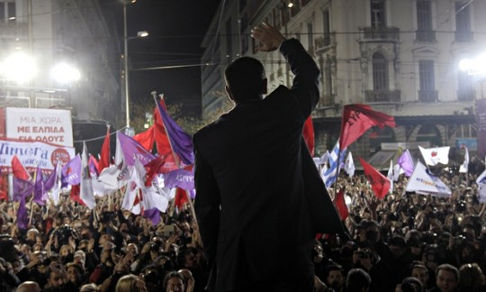 The leader of Syriza, Alexis Tsipras, waves to supporters at a rally in Athens, 22 January 22, 2015.